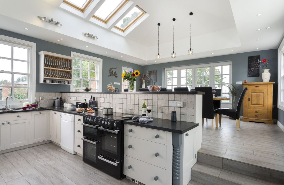 Ground floor: Fully equipped kitchen and dining room with french doors that lead out into the garden