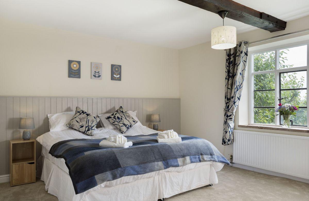 Ground floor: Bedroom with 6' super king size zip and link bed and en-suite shower