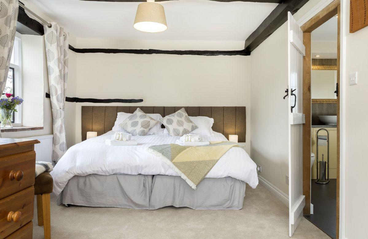 First floor: Bedroom with 6' super king zip and link bed and en-suite bathroom