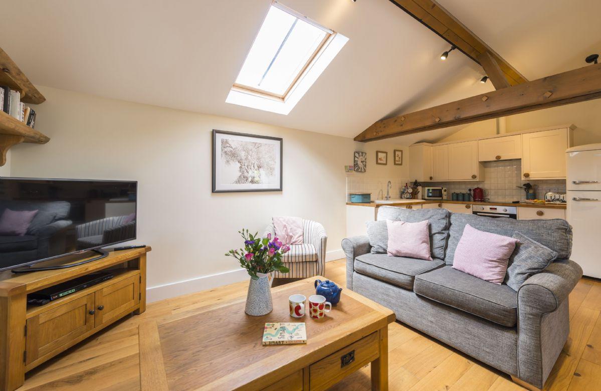 Ground floor:  Sitting room with kitchen beyond