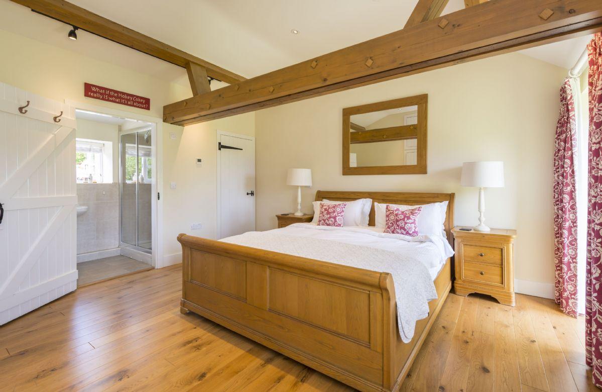 Ground floor:  Bedroom with super-king bed and en-suite shower room