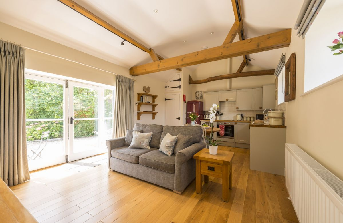 Ground floor:  Open plan sitting room, kitchen and dining area