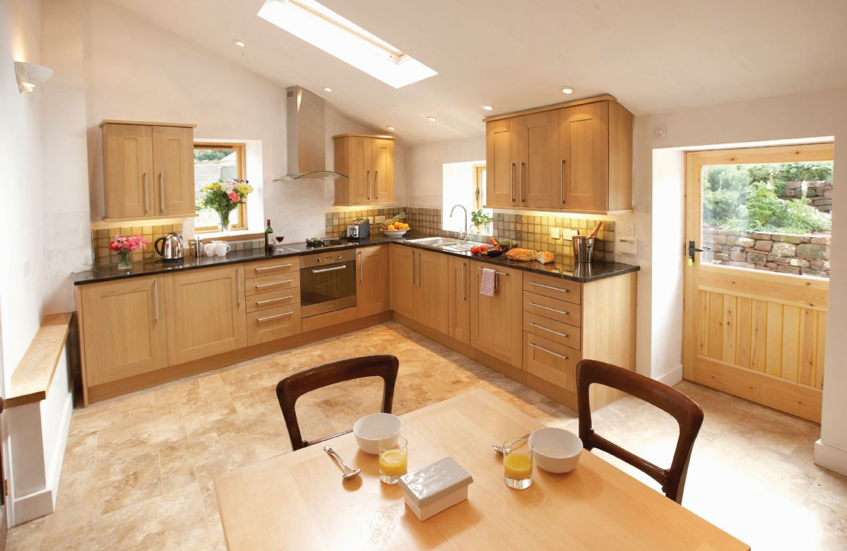 Ground floor: Large kitchen with breakfast table and seating for four guests