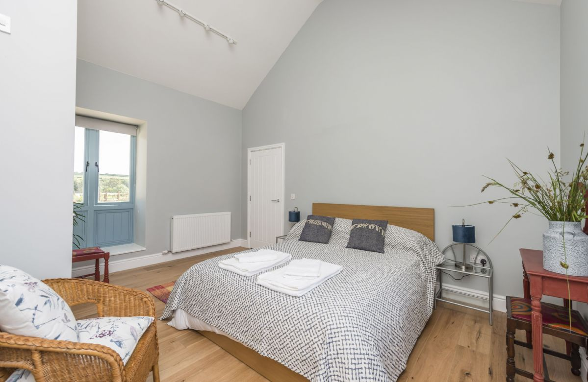 Ground floor:  Bedroom one with king-size bed and en-suite shower room