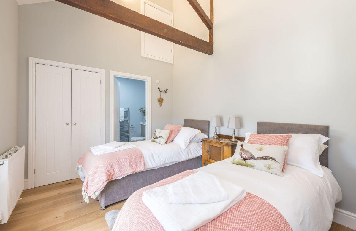 First floor: Bedroom four with twin 2'6 beds and en-suite shower room