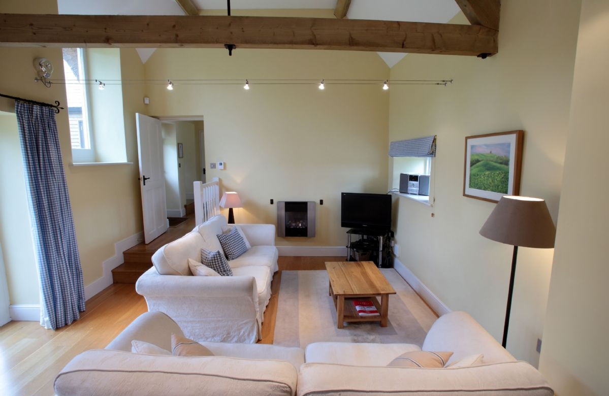 Ground floor:  Sitting room with vaulted ceiling and exposed beams