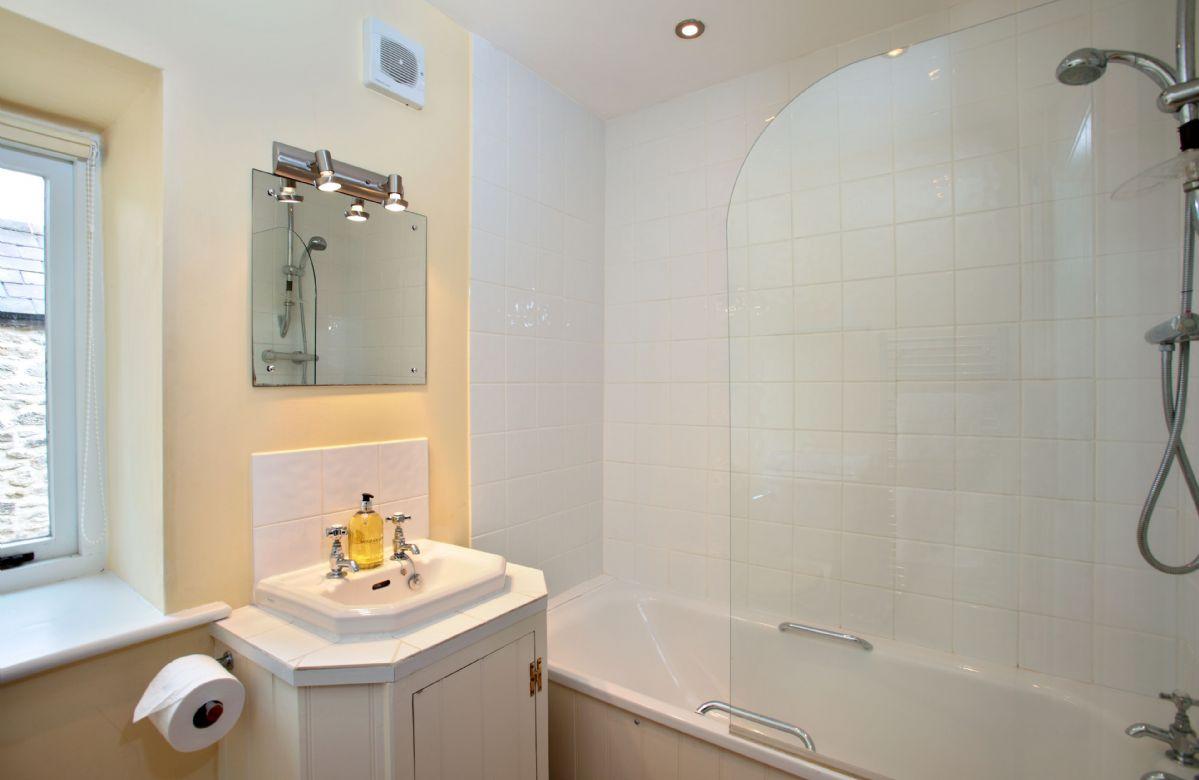 Ground floor:  Family bathroom with bath and shower over