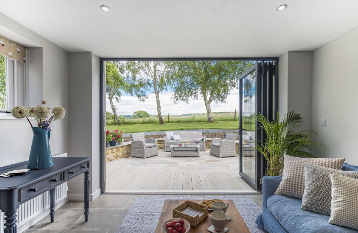 Ground floor: Bi-fold doors from the day room open on to the terrace