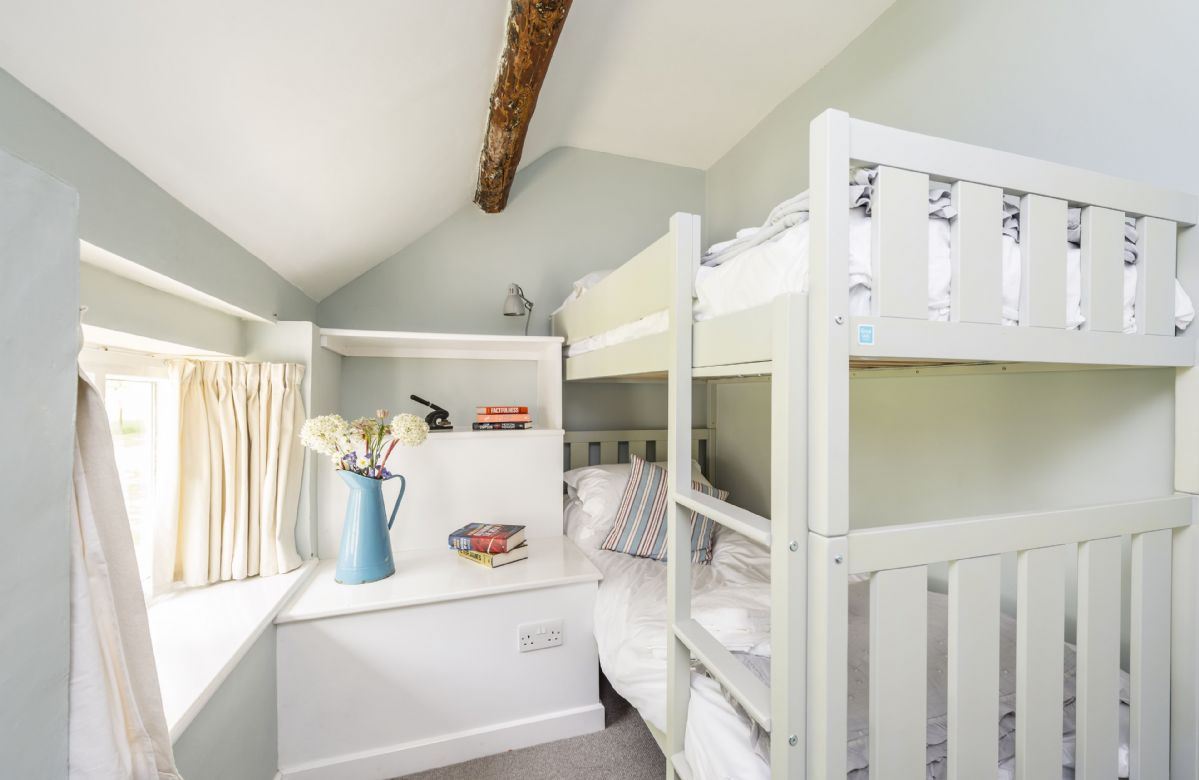 First floor: Bedroom three with bunk beds suitable for children