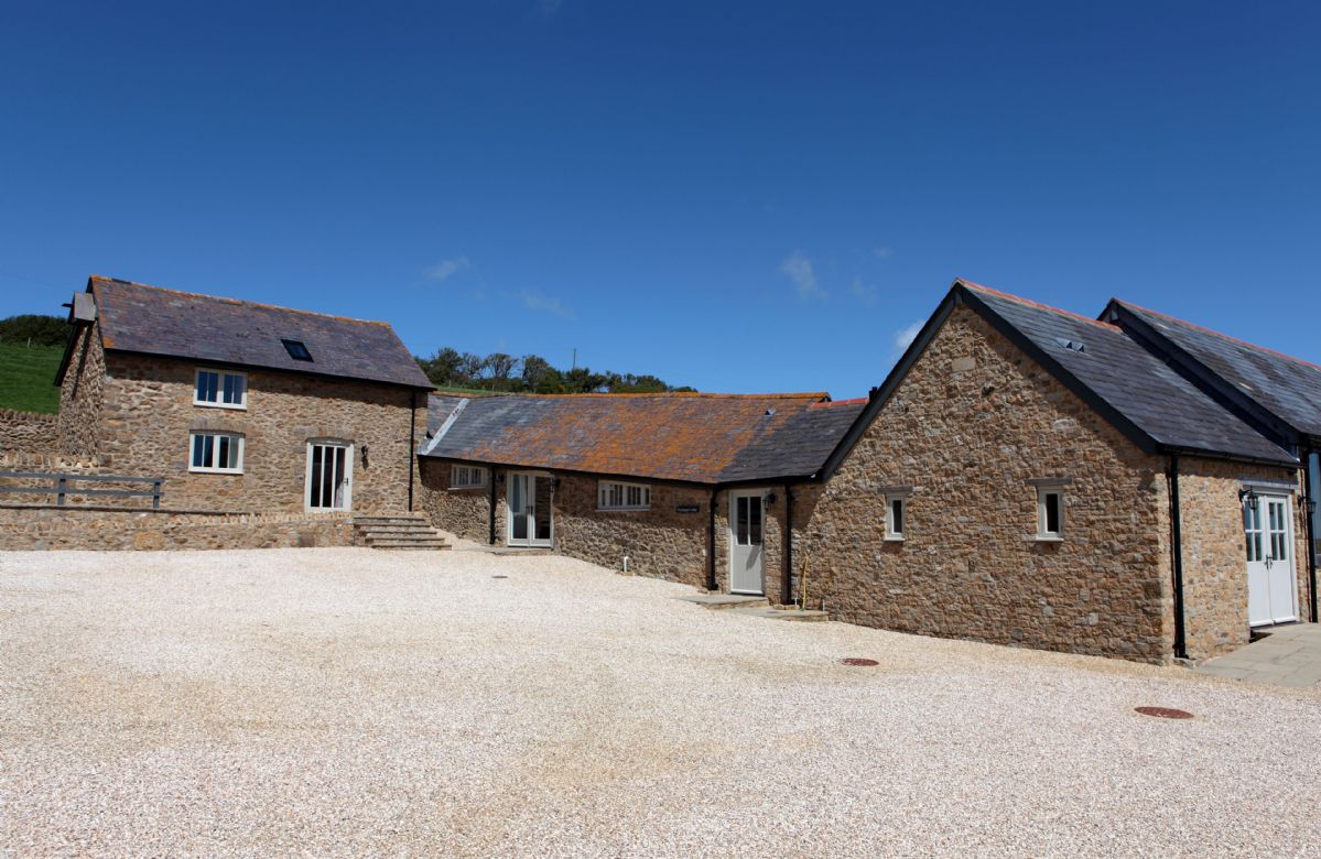 Clayhanger Lodge is a spacious, converted detached barn which offers spectacular views of the surrounding Dorset countryside