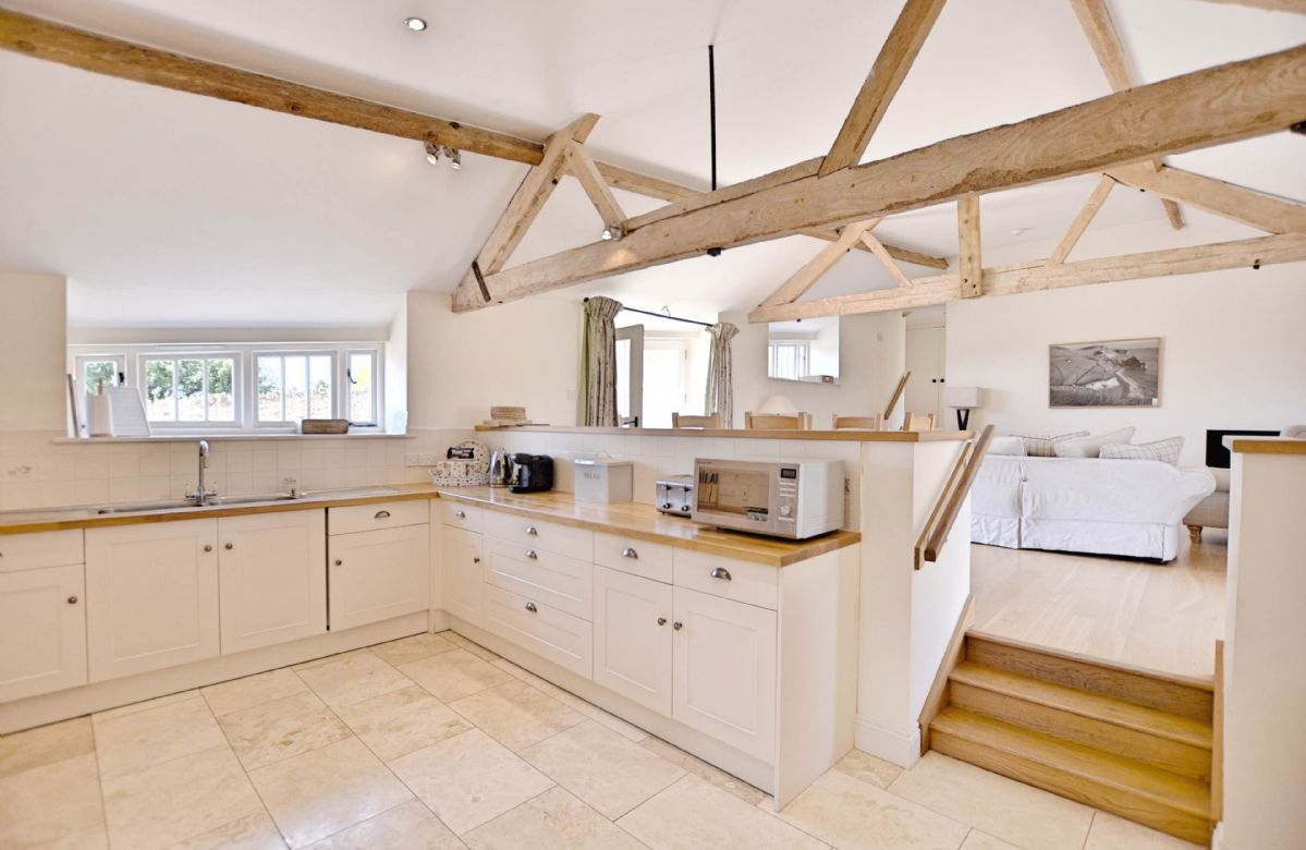 Ground floor:  Kitchen with steps up to dining and sitting room on the upper ground floor