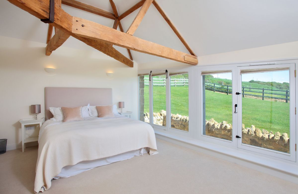 Upper ground floor: Bedroom one with super-king bed and en-suite bathroom