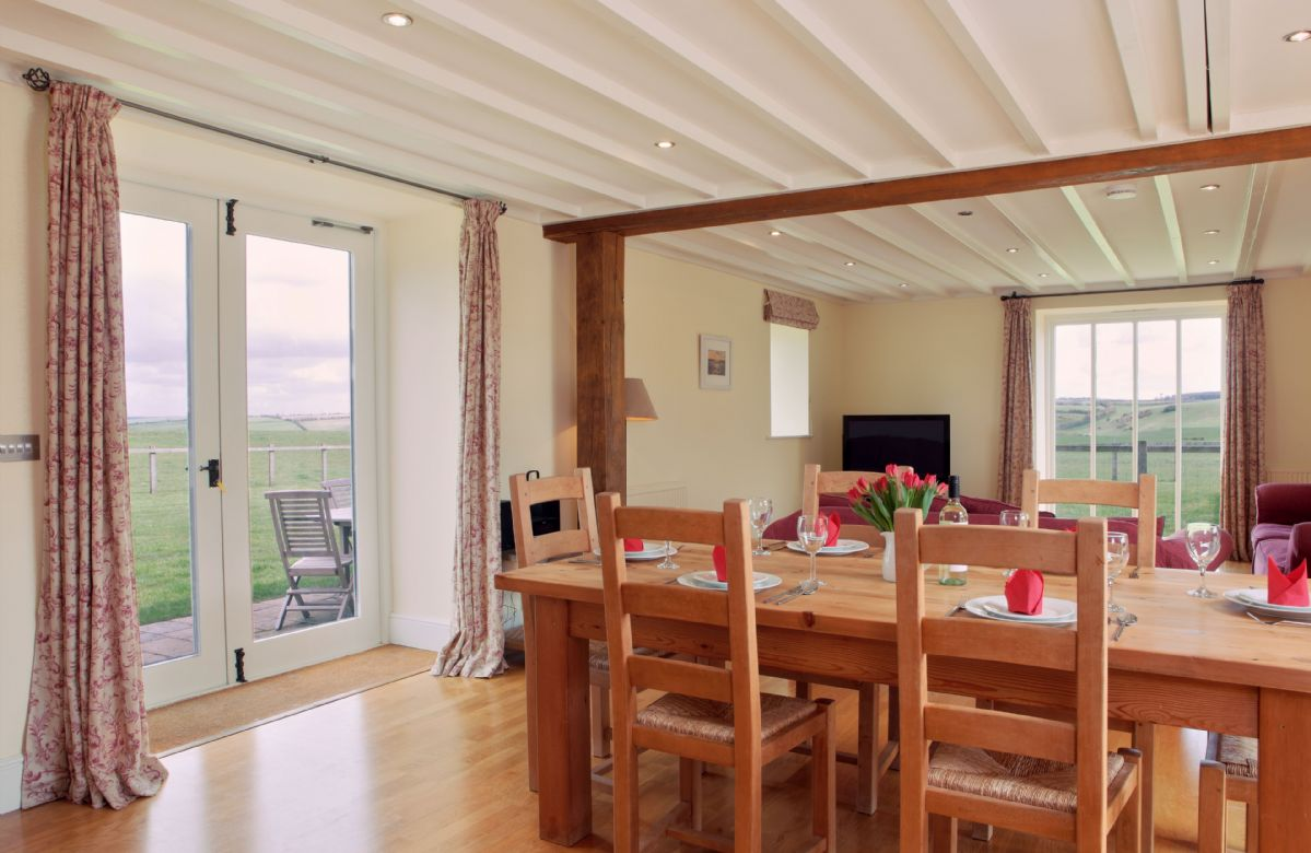 Ground floor: Dining room with doors to the garden and lovely views