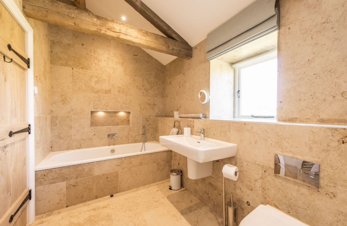 Ground floor: En-suite bathroom with bath and separate walk in shower