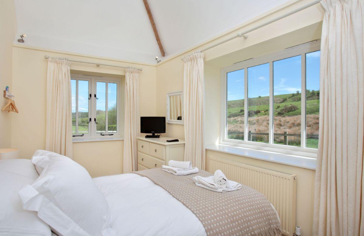 Ground floor: Bedroom one with double bed