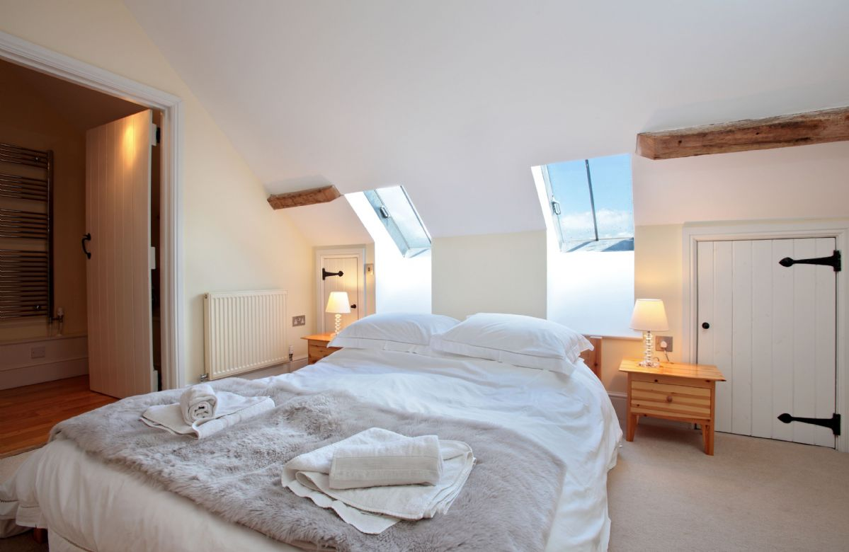 Mezzanine level:  Bedroom three with king-size bed and en-suite bathroom