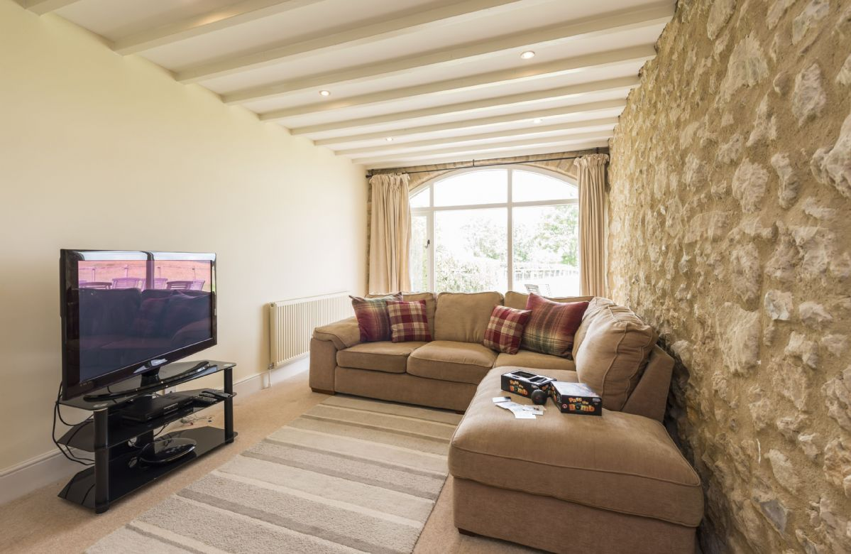 Ground floor: Comfortable snug with television, DVD player and a selection of DVDs.