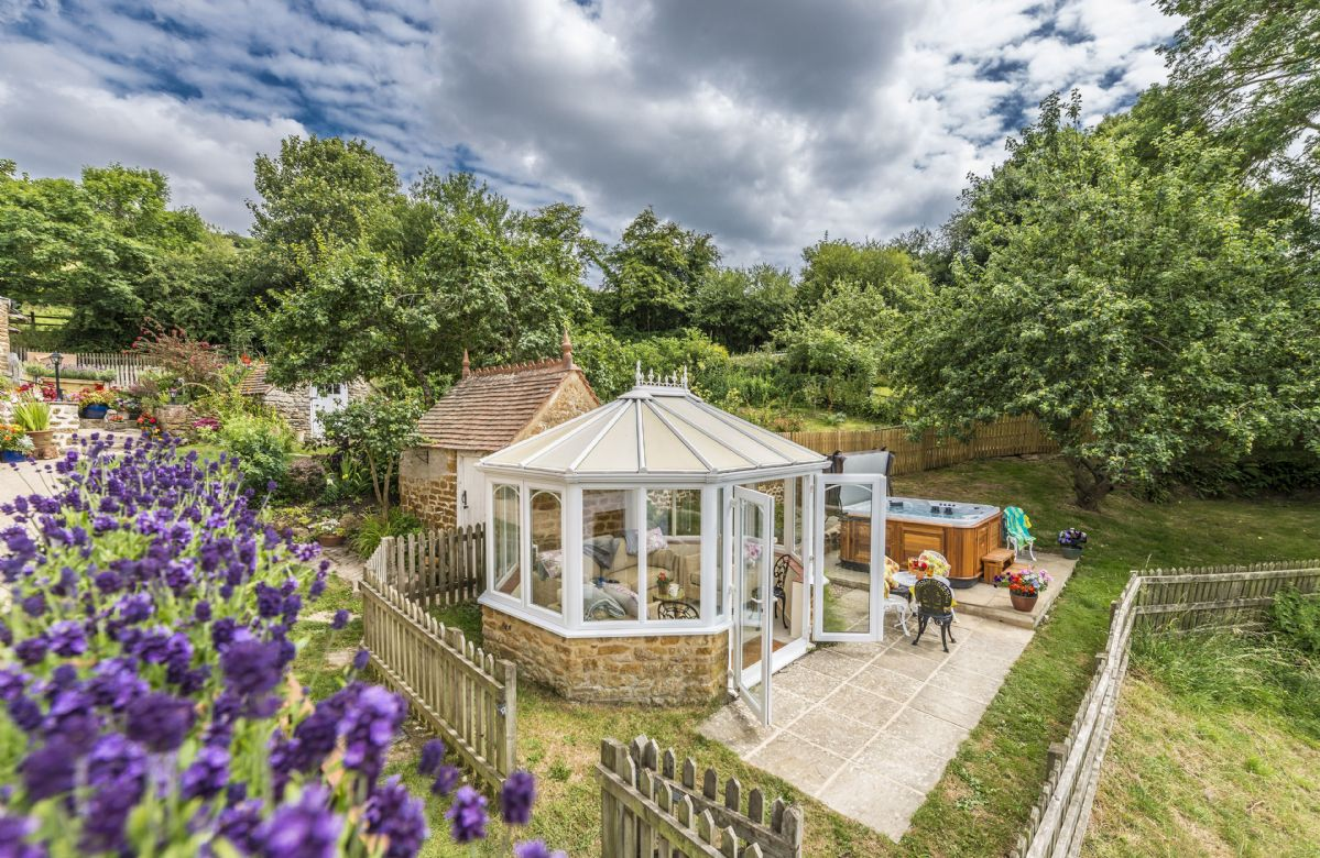 Garden patio with hot tub, garden room and stunning views