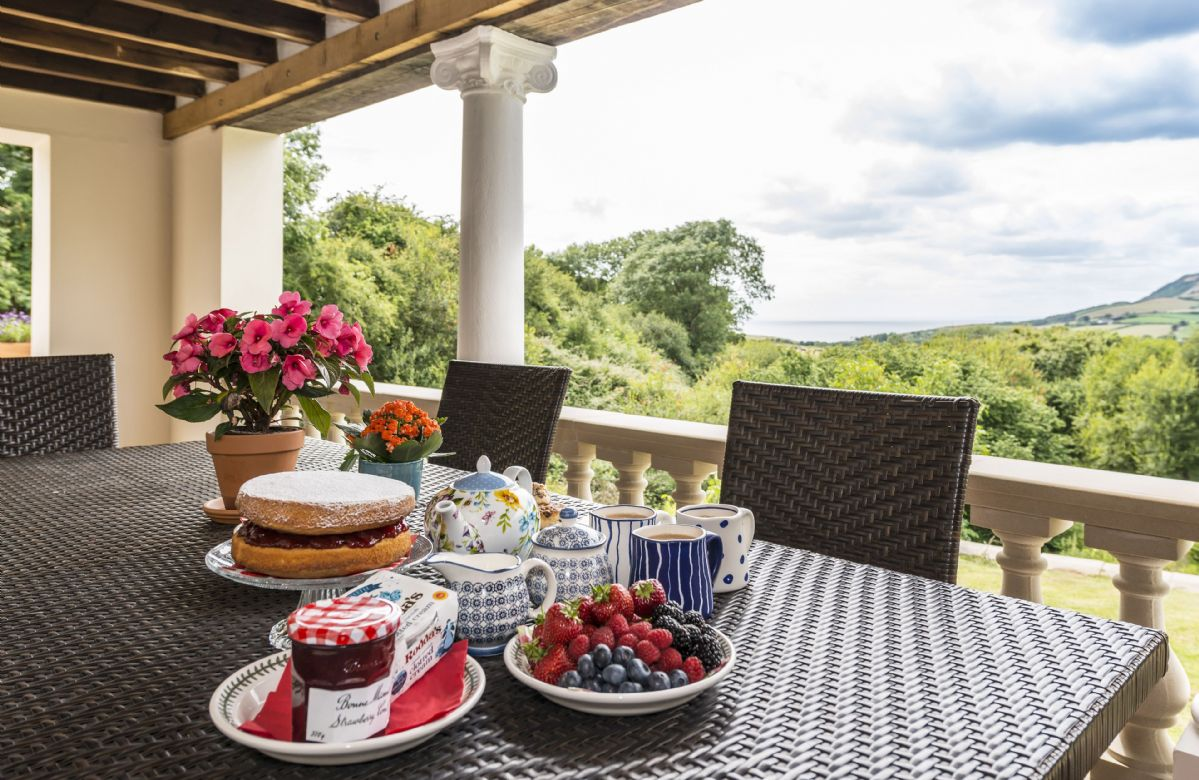 Table and chairs for dining on the veranda with extensive views