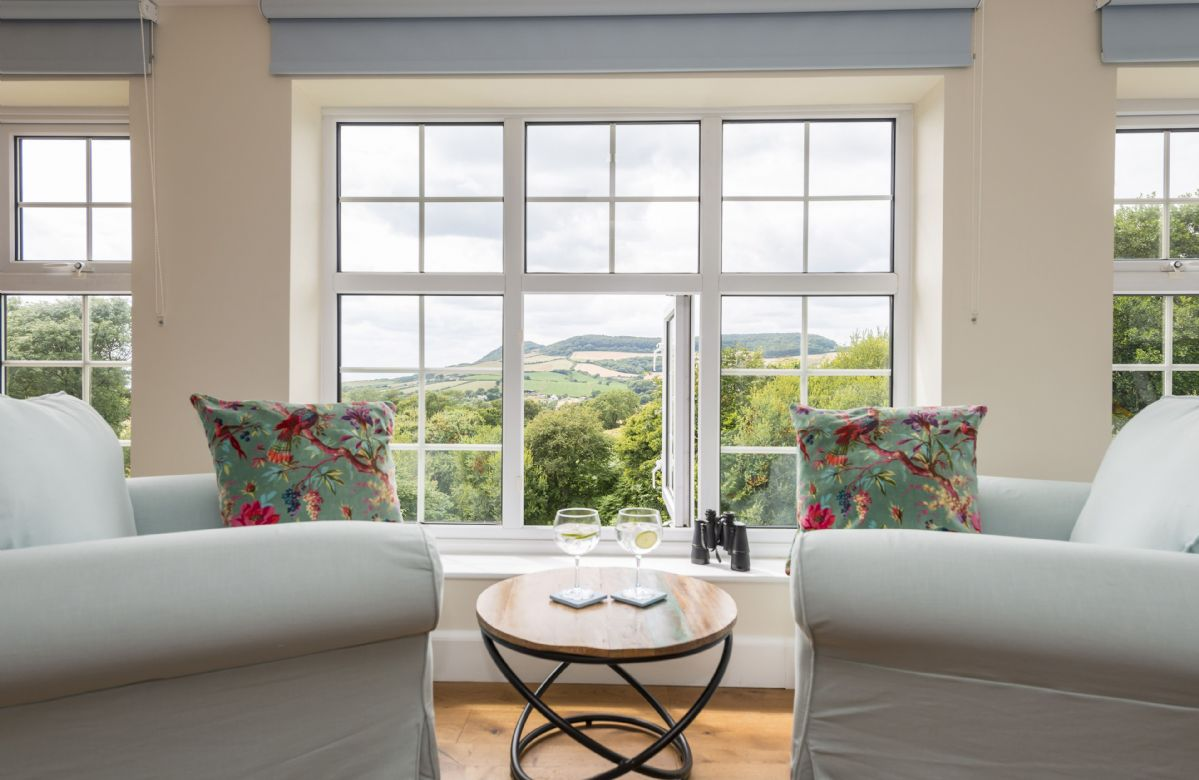First floor: Master bedroom suite with stunning sea and rural views