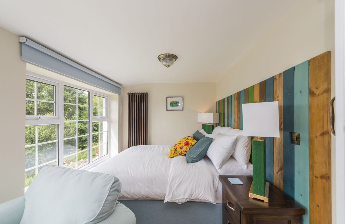 First floor: Master bedroom suite with king-size bed
