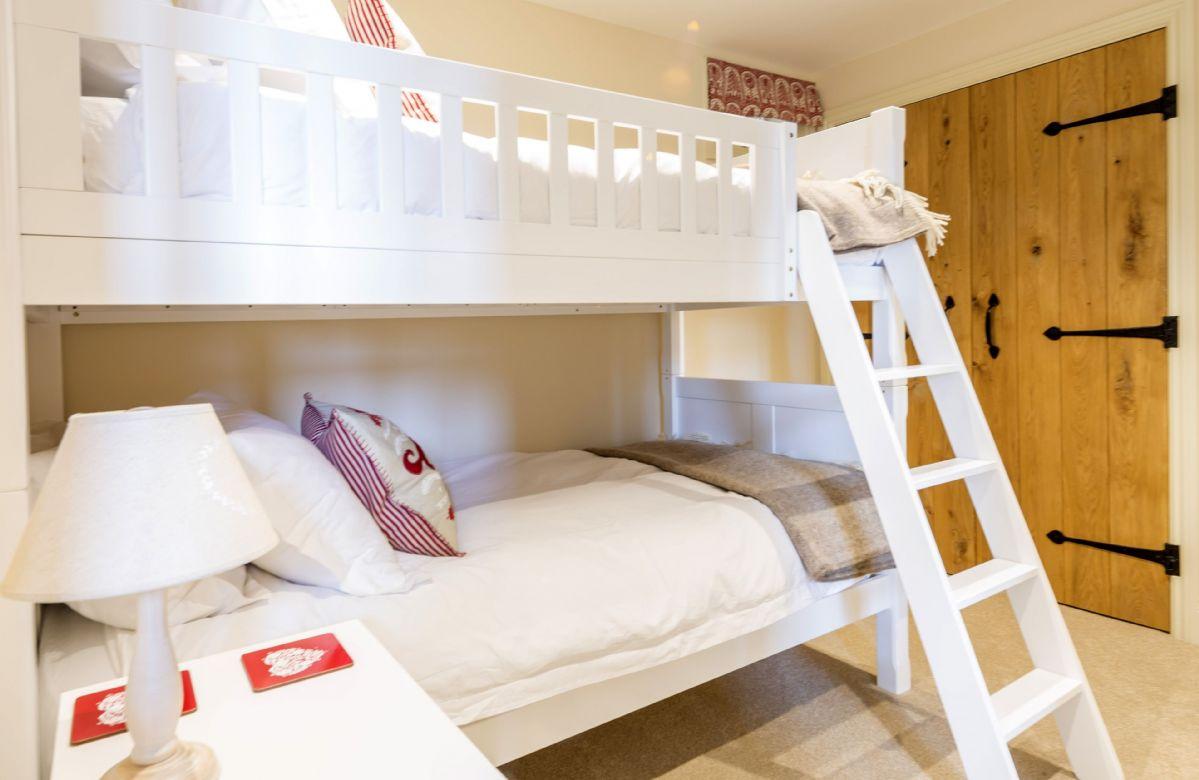 Ground floor: Bedroom three with bunk beds suitable for children and en-suite shower room