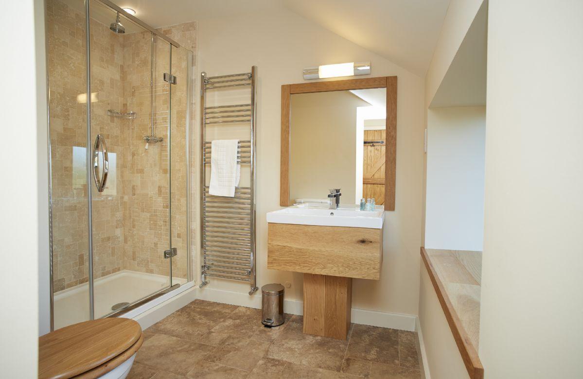 First floor: En-suite belonging to Bedroom 5