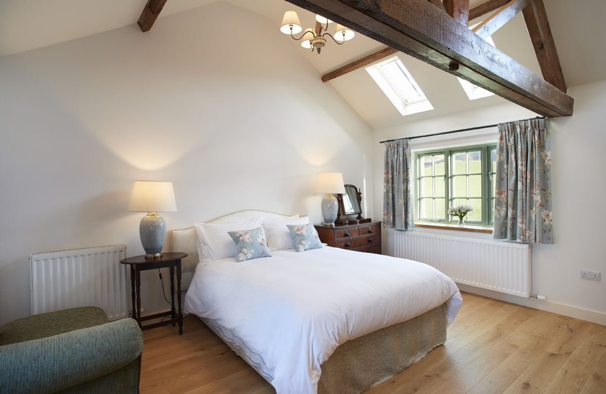 First floor: Bedroom 5 with 5' king size bed and en suite shower.