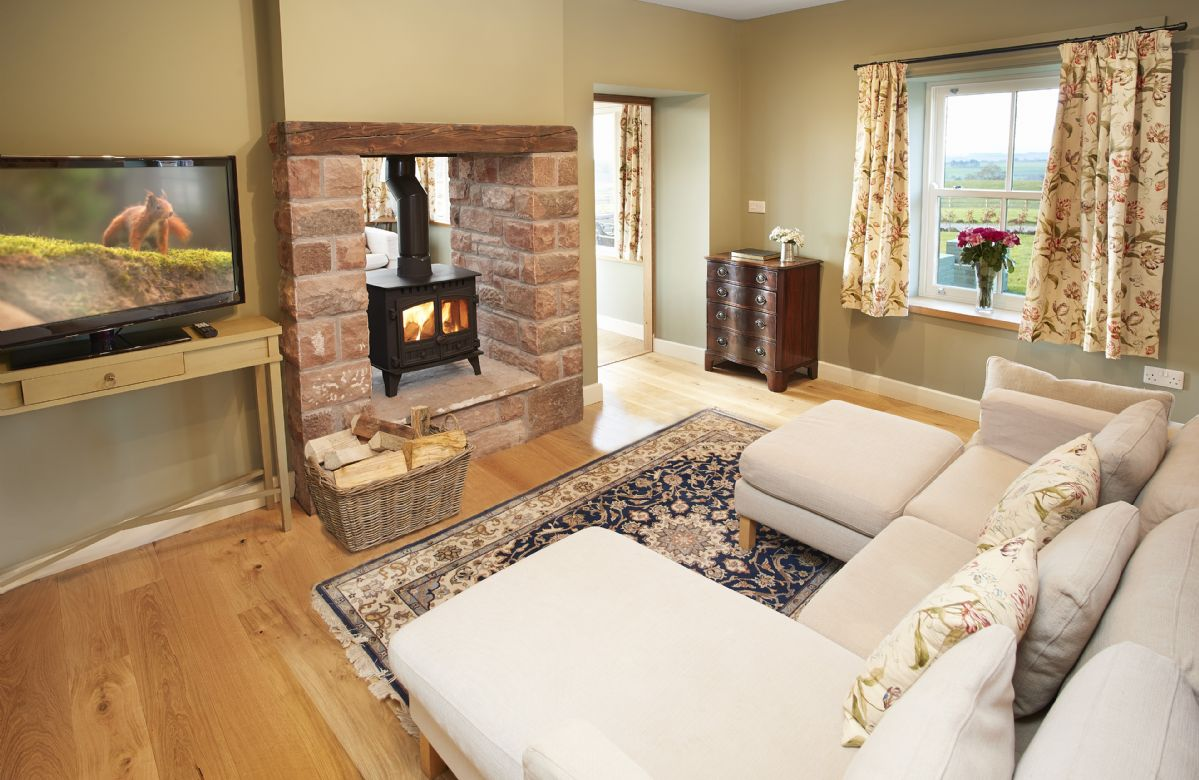 Ground floor: Sitting room with stunning feature wood burner