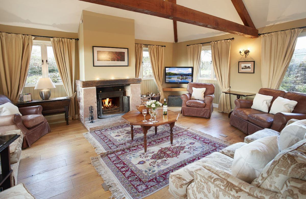 Ground floor: Spacious sitting room with open fire