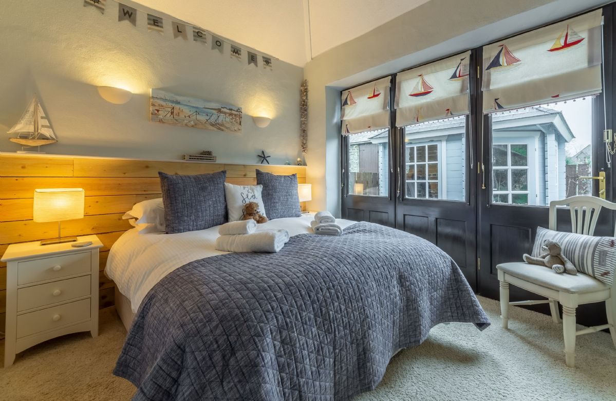 Ground floor: Bedroom two with zip and link bed which can be configured as a king-size bed or two 2'6 beds on request