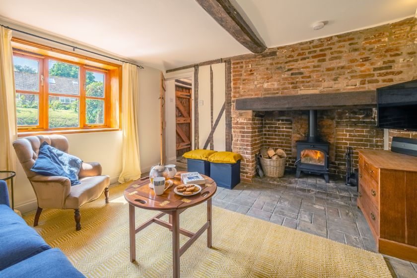 Ground floor: Sitting room with large inglenook fireplace