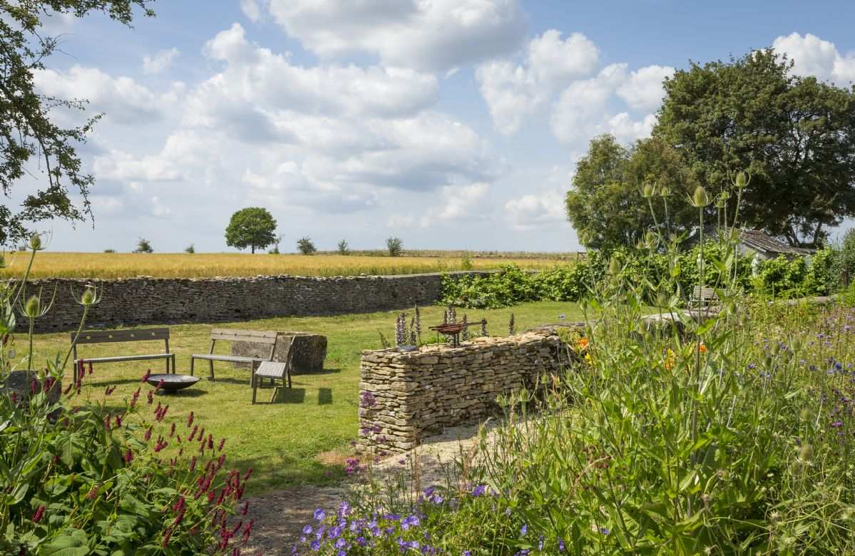 Additional seating in the gardens at Hailstone Barn