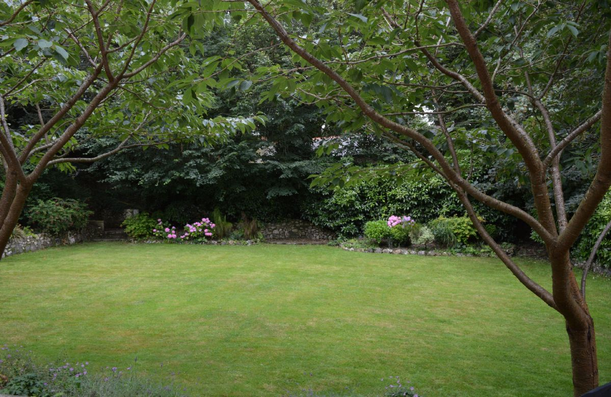 The house is surrounded by a large well stocked garden and two terraces