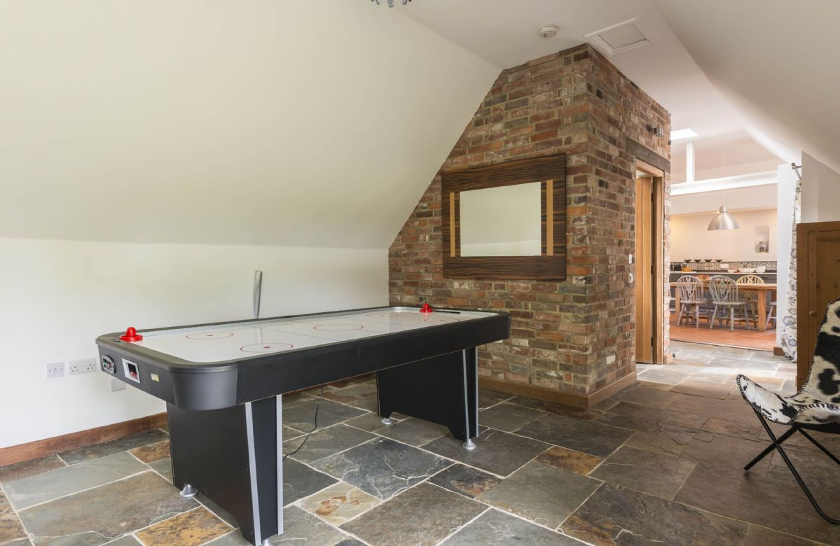 Ground floor: Air hockey table in the family room