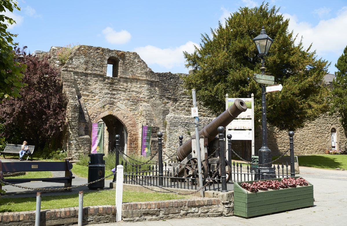 Ludlow Castle is a ruined medieval fortification standing on a promontory overlooking the River Teme