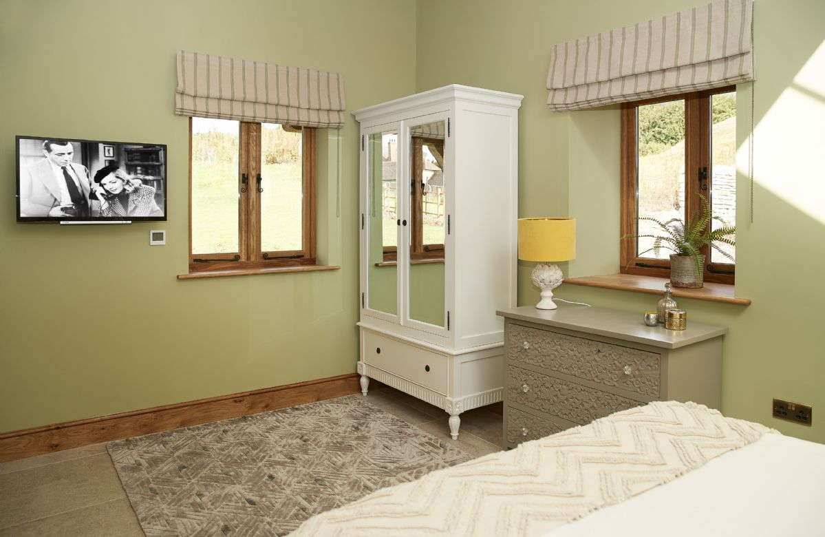 Ground floor: Master bedroom with a king size bed and en-suite bathroom