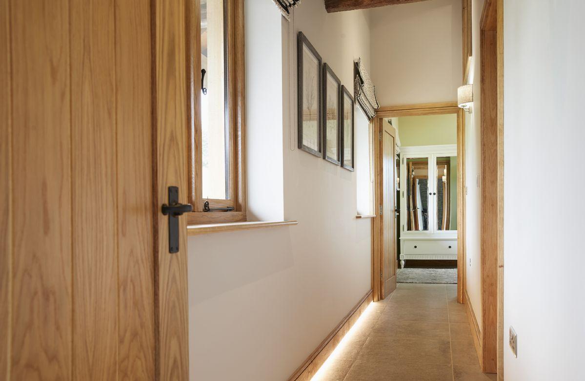 Ground floor: Hallway leading through to the bedrooms