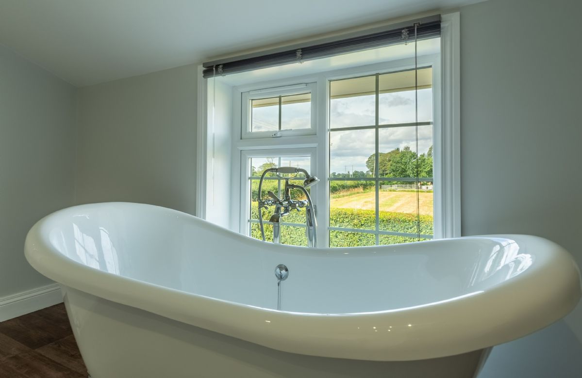 First floor: Freestanding bath with view overlooking the fields