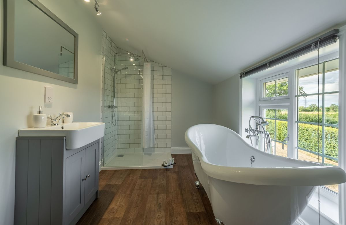 First floor: Modern bathroom with freestanding bath and separate walk-in shower