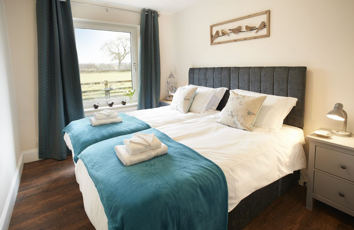 Ground floor:  Second bedroom with 6' zip and link bed which can be converted to two 3' twin beds on request