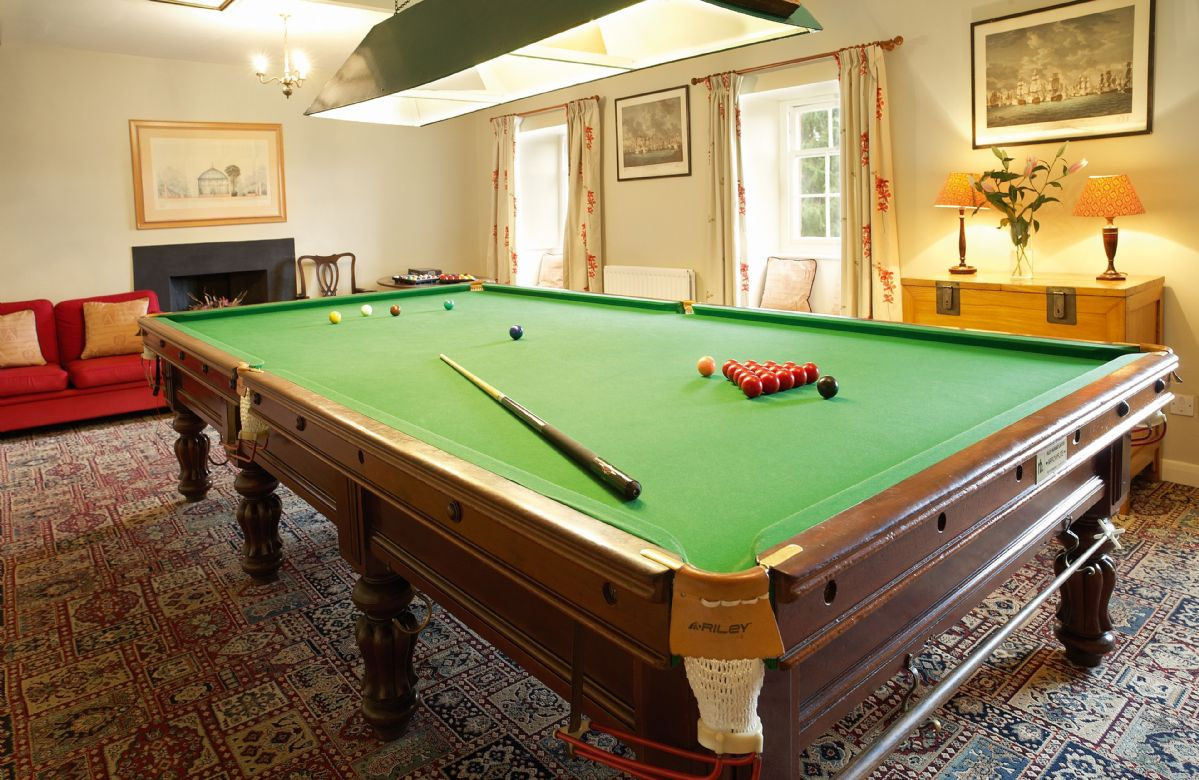 The billiards room has a full-size table and an open fire