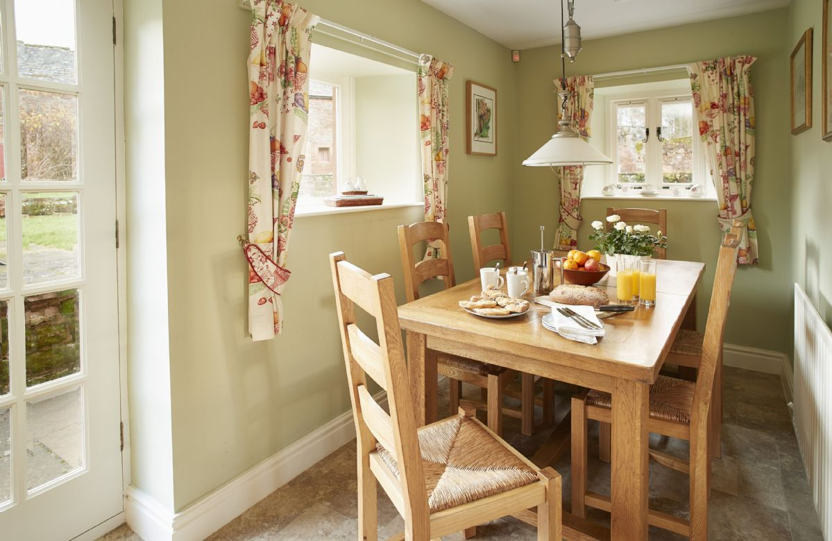 Ground floor: Breakfast table seating six guests