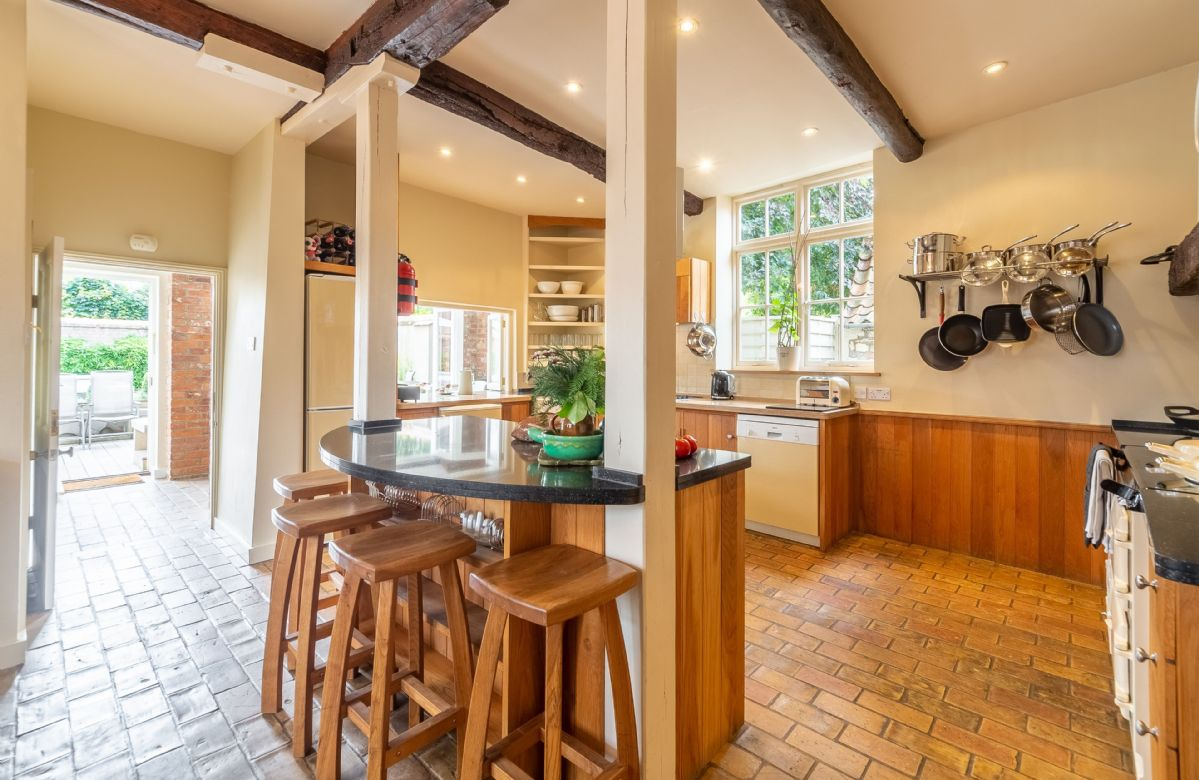 Ground floor: Large kitchen with breakfast bar and stools