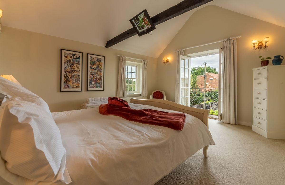 First floor: Master bedroom with Juliet balcony over looking the garden below