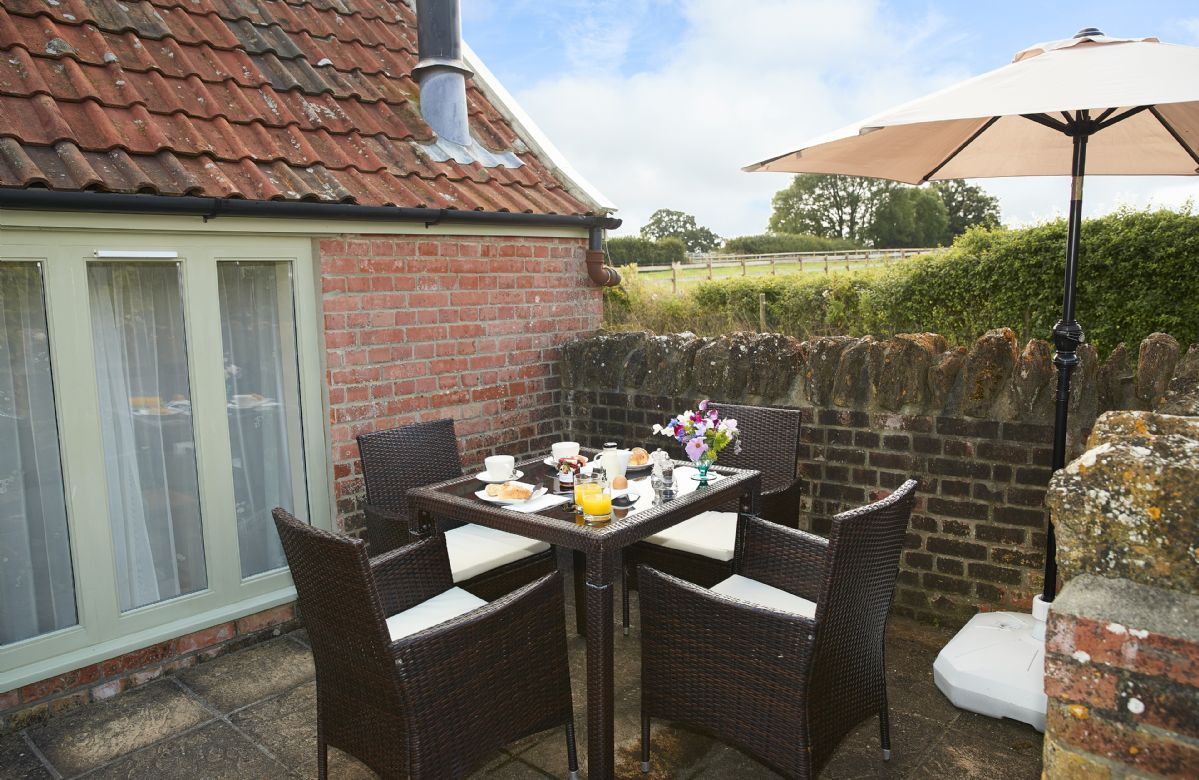 Private outside space with garden furniture seating four guests