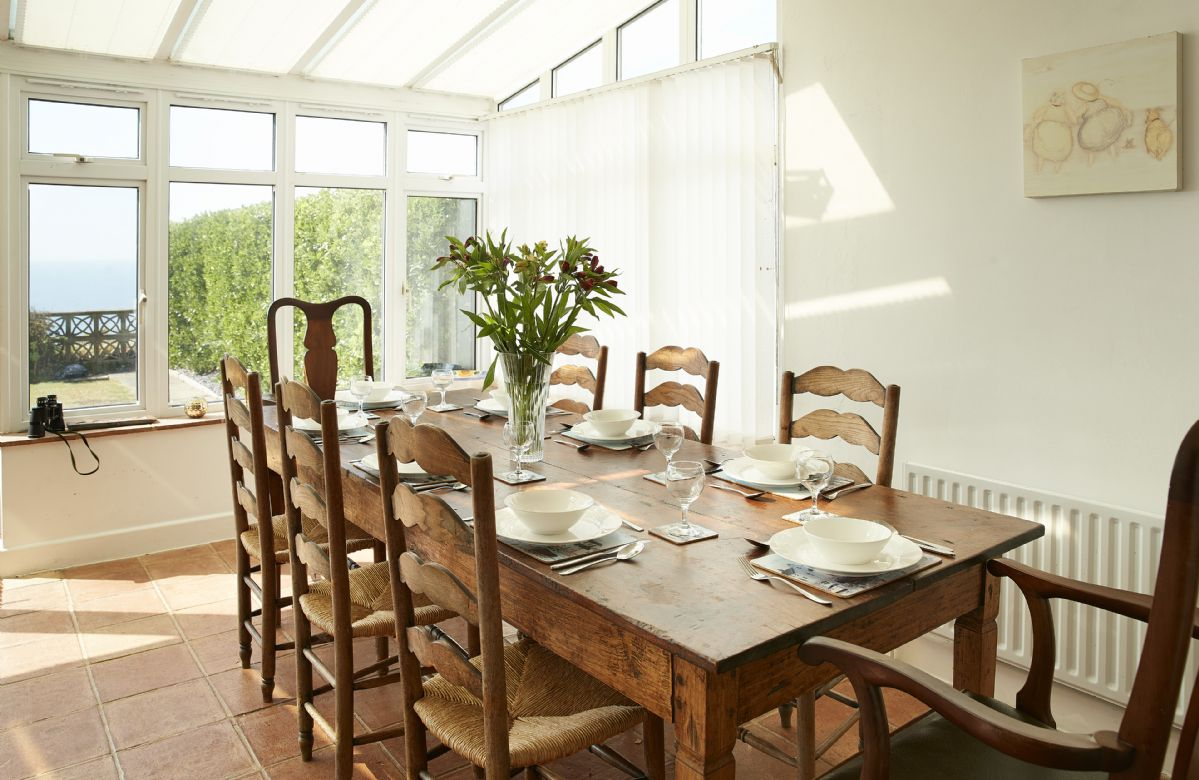 Ground floor: Dining table in the conservatory seating eight guests