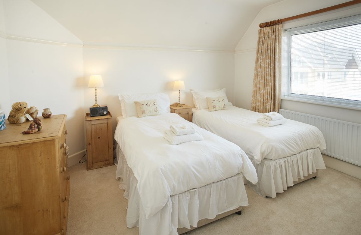 First floor: Double bedroom with 3' zip and link beds which can be converted into a super king size bed on request