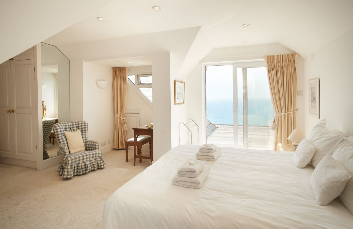 First floor: Bedroom with 6' super king-size zip and link bed with luxury en suite and decking area