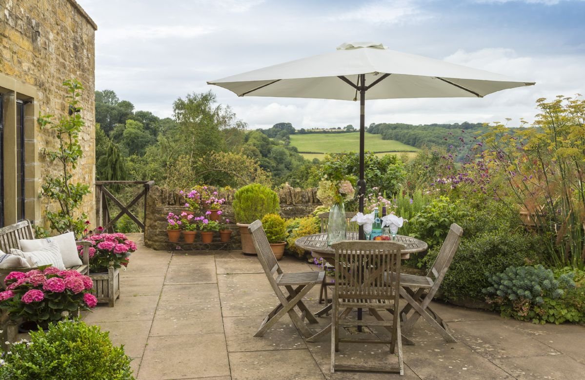 Outside is a terrace area with a table and seating for four where you can enjoy the idyllic views across the Cotswold countryside